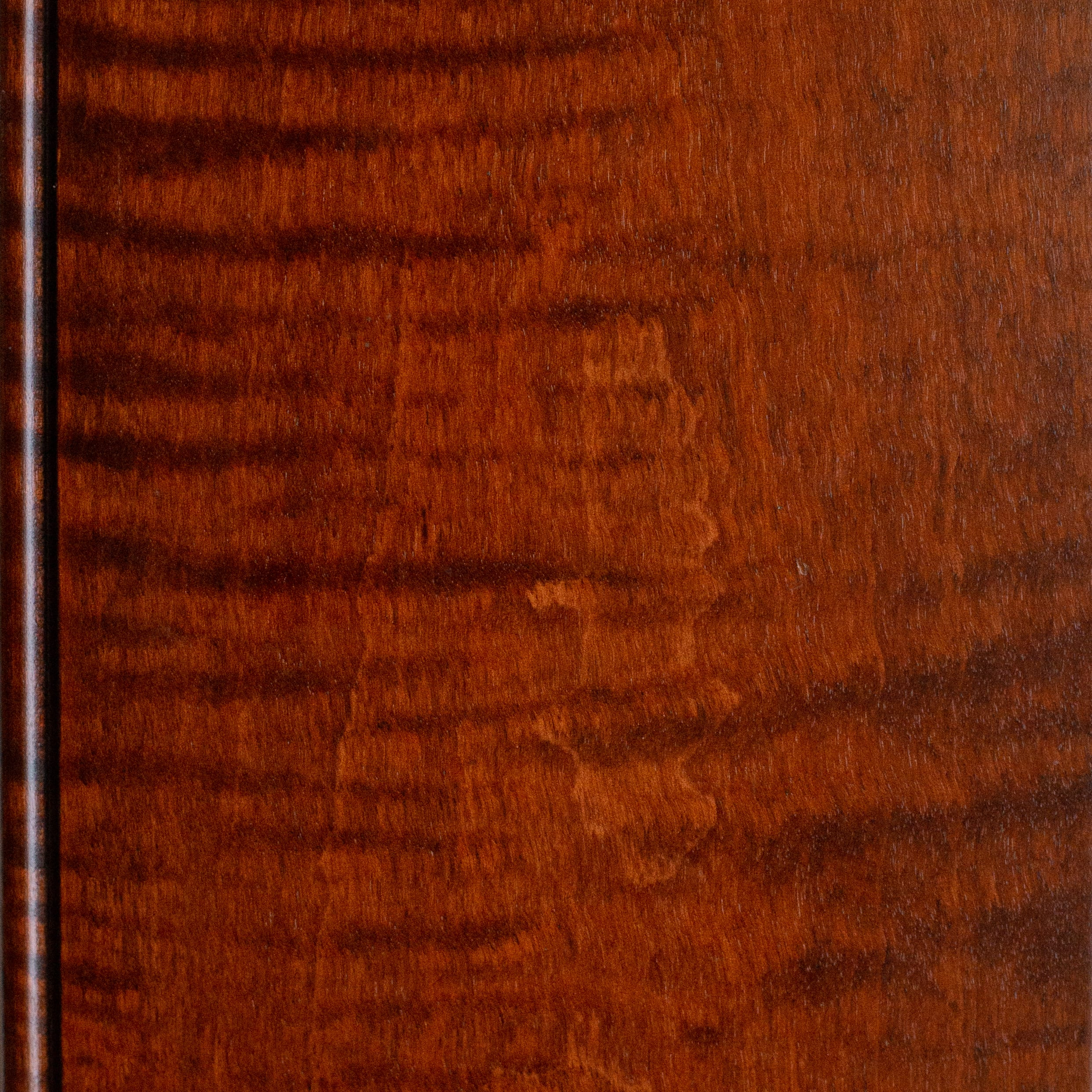 Antique Cherry on curly maple